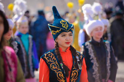 A Kazakh Girl in Traditional Clothing